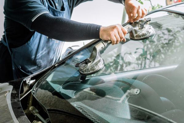 mechanics-man-changing-broken-windshield-automobile-windshield-windscreen-replacement-white-car-auto-repair-shop (Copy)